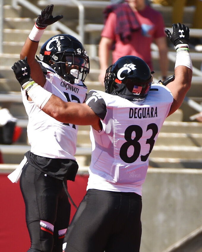 Cincinnati wide receiver Rashad Medaris, left, celebrates his touchdown with Josiah Deguara during the first half of an NCAA college football game against Houston, Saturday, Oct. 12, 2019, in Houston. (AP Photo/Eric Christian Smith)