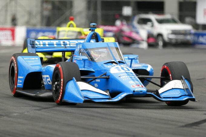 NTT IndyCar series winner Alex Palou (10) takes Turn 10 during the Grand Prix of Long Beach auto race, for a fourth-place finish, Sunday, Sept. 26, 2021, in Long Beach, Calif. (AP Photo/Alex Gallardo)