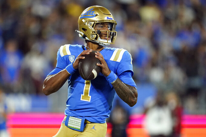 UCLA quarterback Dorian Thompson-Robinson looks for a receiver during the first half of the team's NCAA college football game against Fresno State on Saturday, Sept. 18, 2021, in Pasadena, Calif. (AP Photo/Marcio Jose Sanchez)