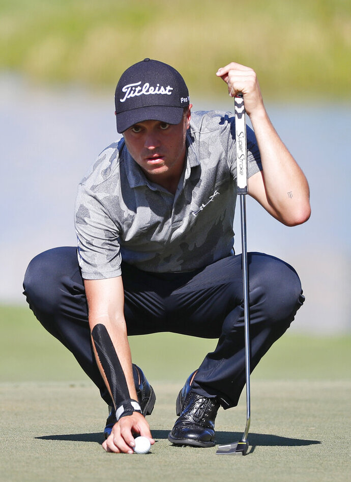 FILE - In this March 2, 2019, file photo, Justin Thomas lines up a putt on the eighth hole during the third round of the Honda Classic golf tournament, in Palm Beach Gardens, Fla. Major champion. FedEx Cup champion. And now Justin Thomas has another title. Matchmaker for Michelle Wie and Jonnie West. Wie, the golf prodigy from Hawaii and former U.S. Women's Open champion, revealed on Instagram earlier this week that she was engaged to West, the Golden State Warriors' director of basketball operations and the son of NBA great Jerry West. And it all started with an exchange of text messages.