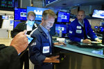Trader Robert Charmak, center, and specialist Meric Gfeenbaum, right, work on the floor of the New York Stock Exchange, Friday, July 23, 2021. Stocks rose in early trading on Wall Street Friday and put the major indexes on track for a strong finish in a week that opened with a stumble. (AP Photo/Richard Drew)