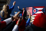 FILE- In this Oct. 12, 2018 file photo then President Donald Trump waves as he arrives for a campaign rally, in Lebanon, Ohio. A GOP-backed bill introduced Monday, April 20, 2021, would change the name of a state park to honor Trump. The House bill primarily sponsored by freshmen Rep. Mike Loychik to rename Mosquito State Park to Donald J. Trump State Park is the latest attempt by Ohio Republicans to honor the former president. (AP Photo/Evan Vucci, File)