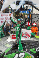 Kyle Larson celebrates his win in the NASCAR Cup Series auto race Sunday, Oct. 6, 2019, at Dover International Speedway in Dover, Del. (AP Photo/Jason Minto)