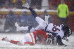 Denver Broncos safety Trey Marshall (36) and safety Will Parks, rear, tackle Kansas City Chiefs wide receiver Sammy Watkins, bottom, during the first half of an NFL football game in Kansas City, Mo., Sunday, Dec. 15, 2019. (AP Photo/Charlie Riedel)