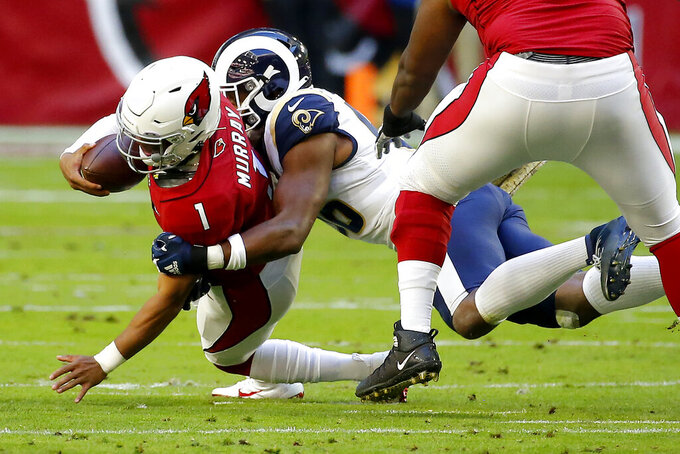 Arizona Cardinals quarterback Kyler Murray is sacked by Los Angeles Rams defensive end Dante Fowler during the first half of an NFL football game, Sunday, Dec. 1, 2019, in Glendale, Ariz. (AP Photo/Rick Scuteri)