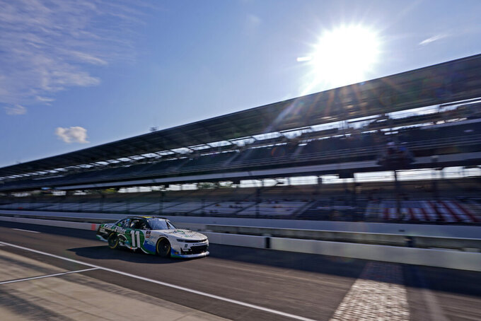 Justin Haley drives down pit lane during practice for the NASCAR Xfinity Series auto race at Indianapolis Motor Speedway, Friday, Aug. 13, 2021, in Indianapolis. (AP Photo/Darron Cummings)