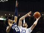 Villanova forward Saddiq Bey (15) defends Seton Hall forward Sandro Mamukelashvili (23) who goes up for a layup during the second half of an NCAA college basketball game, Saturday, March 9, 2019, in Newark, N.J. Seton Hall defeated Villanova 79-75. (AP Photo/Kathy Willens)