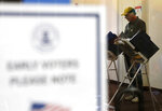 Randy Wick, age 68, fills his midterm election ballot at an early voting poll at a mall in Bloomingdale, Ill., on Thursday, Oct. 25, 2018. Wick, a member of the NRA who