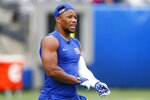 New York Giants running back Saquon Barkley warms up before an NFL preseason football game against the New England Patriots, Sunday, Aug. 29, 2021, in East Rutherford, N.J. (AP Photo/Noah K. Murray)