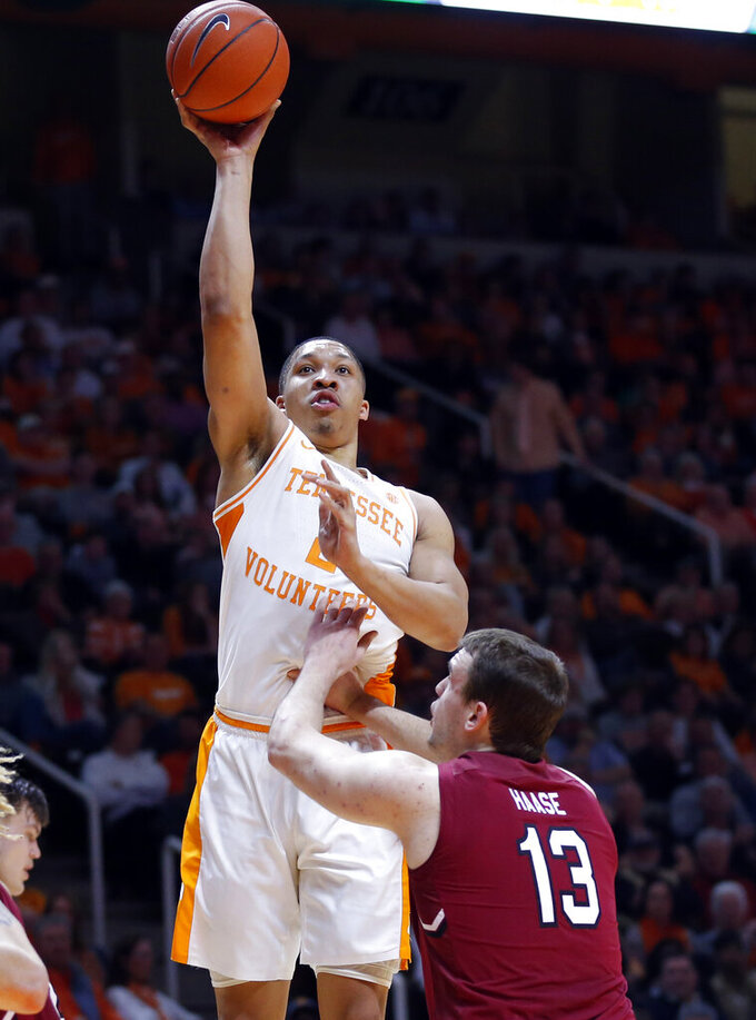 Tennessee forward Grant Williams (2) shoots over South Carolina forward Felipe Haase (13) during the second half of an NCAA college basketball game Wednesday, Feb. 13, 2019, in Knoxville, Tenn. Tennessee won 85-73. (AP photo/Wade Payne)