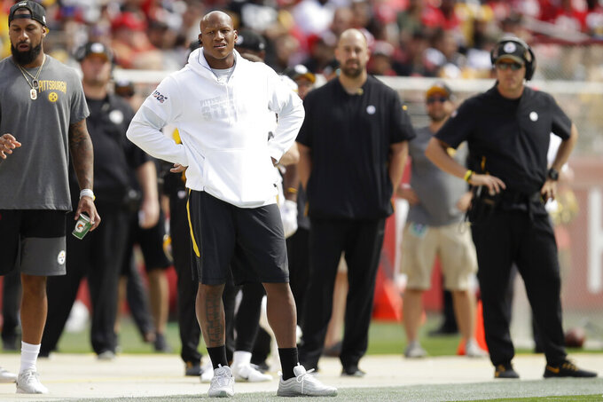 Ryan Shazier, center left, watches from the sideline during the first half of an NFL football game between the San Francisco 49ers and the Pittsburgh Steelers in Santa Clara, Calif., Sunday, Sept. 22, 2019. (AP Photo/Ben Margot)