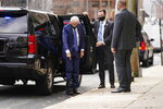 President-elect Joe Biden points to his medical boot as he arrives at The Queen theater, Tuesday, Dec. 1, 2020, in Wilmington, Del. (AP Photo/Andrew Harnik)