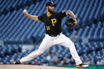 Pittsburgh Pirates starting pitcher Trevor Williams winds up during the first inning of the team's baseball game against the Chicago White Sox in Pittsburgh, Tuesday, May 15, 2018. (AP Photo/Gene J. Puskar)