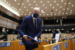 European Council President Charles Michel arrives to the main chamber for a plenary session on the inauguration of the new President of the United States and the current political situation, at the European Parliament in Brussels, Wednesday, Jan. 20, 2021. (AP Photo/Francisco Seco, Pool)