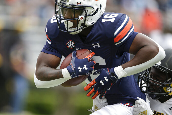Auburn wide receiver Malcolm Johnson Jr. (16) catches a pass for a touchdown as Alabama State defensive back Rodney Echols (25) defends during the second half of an NCAA football game Saturday, Sept. 11, 2021, in Auburn, Ala. (AP Photo/Butch Dill)