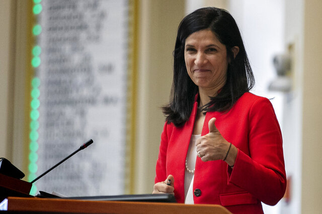 """FILE - In this Jan. 8, 2020 file photo, House speaker Sara Gideon, D-Freeport, flashes a thumbs up at a Democratic colleague prior to the start of the first session of the new year at the State House House in Augusta, Maine. Planned Parenthood announced Tuesday that it is endorsing Gideon, a Democratic challenger to Republican Sen. Susan Collins in Maine, saying Collins """"turned her back"""" on women and citing her vote to confirm Brett Kavanaugh to the Supreme Court as well as other judicial nominees who oppose abortion.  (AP Photo/Robert F. Bukaty)"""