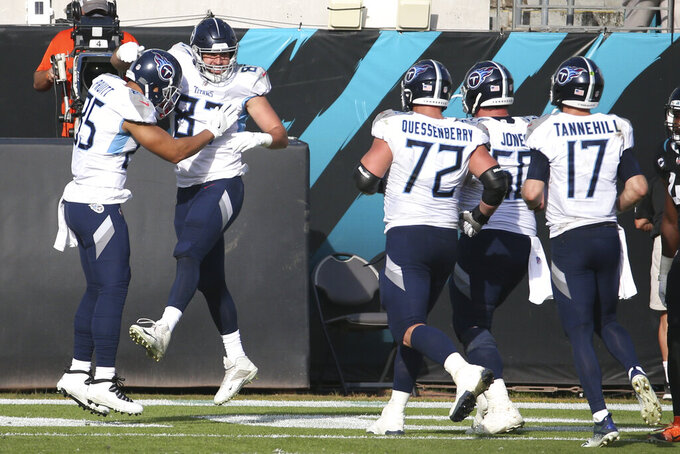 Tennessee Titans tight end Geoff Swaim, second from left, celebrates his touchdown reception against the Jacksonville Jaguars with teammates during the second half of an NFL football game, Sunday, Dec. 13, 2020, in Jacksonville, Fla. (AP Photo/Stephen B. Morton)