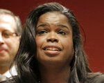 FILE - In this Dec. 2, 2015, file photo, Kim Foxx, then a candidate for Cook County state's attorney, speaks at a news conference in Chicago. Foxx, now the Cook County State's Attorney, says she hopes to begin expunging minor cannabis convictions in the coming months but acknowledges it won't be easy to implement her plan and that her office is still figuring out its scope. Foxx told the Chicago Sun-Times last week that she estimates that thousands of misdemeanor drug convictions could be wiped out. Foxx says her office is also reviewing its policy toward prosecuting those detained for selling marijuana. (AP Photo/M. Spencer Green, File)