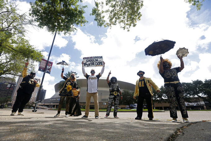 "New Orleans Saints ""superfans"" participate in a moment of solidarity outside the Superdome before an NFL football game between the Saints and the Tampa Bay Buccaneers in New Orleans, Sunday, Sept. 13, 2020. The game is being played without fans due to the COVID-19 pandemic. (AP Photo/Brett Duke)"