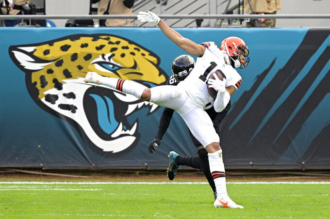 FILE - Cleveland Browns wide receiver KhaDarel Hodge (12) catches a pass in front of Jacksonville Jaguars cornerback Luq Barcoo (36) during the first half of an NFL football game in Jacksonville, Fla., in this Sunday, Nov. 29, 2020, file photo. The Cleveland Browns signed restricted free agent wide receiver KhaDarel Hodge, one of their top special teams players. The team had placed a tender worth $2.33 million on Hodge. The 26-year-old Hodge appeared in nine games last season with Cleveland, making 11 catches for 180 yards.  (AP Photo/Phelan M. Ebenhack, File)