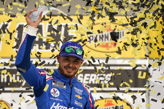 FILE - Kyle Larson celebrates after winning a NASCAR Cup Series auto race in Las Vegas, in this Sunday, March 7, 2021, file photo. Kyle Larson will return to iRacing this week almost a year after a slur he used while on the online racing platform nearly cost him his career. (AP Photo/John Locher, File)