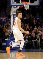 New York Knicks' Kevin Knox reacts after hitting a three-point basket during the second half of the NBA basketball game against the Philadelphia 76ers, Sunday, Jan. 13, 2019, in New York. (AP Photo/Seth Wenig)