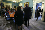 Virginia Governor Ralph Northam, right, enters a meeting of his Cabinet at the State Capitol in Richmond, Va., Wednesday, Nov. 6, 2019. After the meeting, Northam was questioned about the previous night's election results which gave Democrats control of the Virginia House of Delegates and Senate. (Bob Brown/Richmond Times-Dispatch via AP)