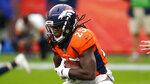 FILE  - In this Sunday, Sept. 27, 2020, file photo, Denver Broncos running back Melvin Gordon runs with the ball during the second half of an NFL football game against the Tampa Bay Buccaneers, in Denver. Gordon wasn't at practice Wednesday, Oct. 14, 2020, after being cited for driving under the influence and speeding by Denver police the night before. (AP Photo/David Zalubowski, File)