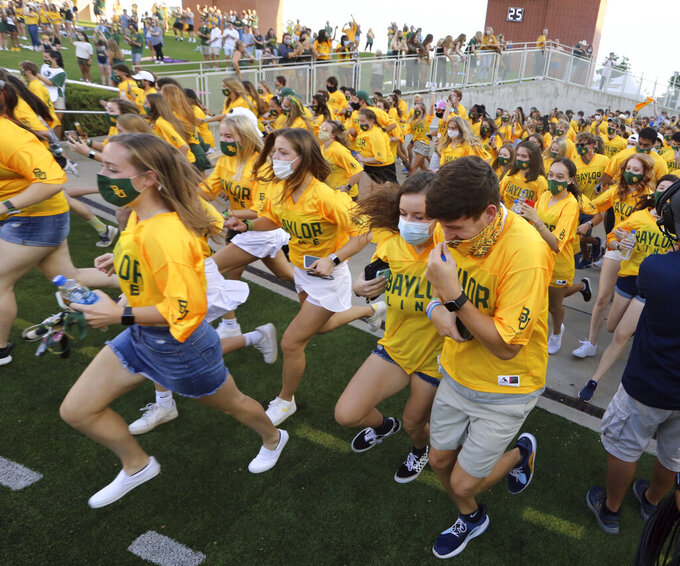 Baylor Freshman Line run on to the field during their season opener with Kansas at an NCAA college football game, Saturday, Sept. 65, 2020, in Waco, Texas. (Rod Aydelotte/Waco Tribune-Herald via AP)