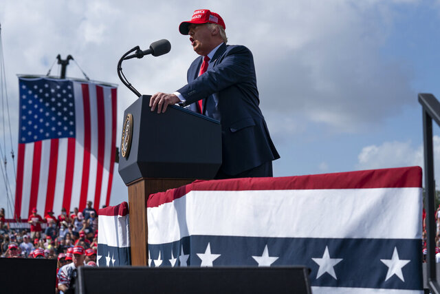 President Donald Trump speaks during a campaign rally outside Raymond James Stadium, Thursday, Oct. 29, 2020, in Tampa. (AP Photo/Evan Vucci)