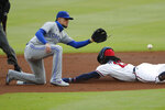 Atlanta Braves' Ronald Acuna Jr. (13) steals second base ahead of the throw to Toronto Blue Jays second baseman Cavan Biggio (8) in the first inning of a baseball game Tuesday, Aug. 4, 2020, in Atlanta. (AP Photo/John Bazemore)