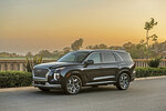 This image provided by Hyundai shows the 2021 Hyundai Palisade. Truck and SUV sales are hotter than ever. If you need a mode of transportation for a growing family, what would be best for you — a truck, SUV or maybe a minivan? (Hyundai via AP)