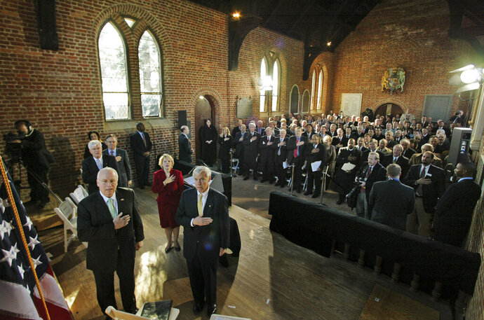 FILE - In this Jan. 10, 2007, file photo, Vice President Dick Cheney, left, is joined by Virginia House of Delegates speaker, William Howell, R-Stafford, front right, and others in the the Pledge of Allegiance during a commemorative session of the Virginia General Assembly in Historic Jamestown's Memorial Church in Jamestown, Va. Academics, lawmakers, dignitaries and maybe even the president will gather in Virginia this week for events celebrating the beginnings of American democracy four centuries ago. Tuesday, July 30, 2019, marks the 400th anniversary of the first meeting of the House of Burgesses. (AP Photo/Steve Helber, File)