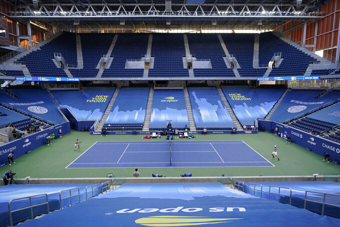Jordan Thompson, right, of Australia, plays against Borna Coric, of Croatia, during the fourth round of the US Open tennis championships, Sunday, Sept. 6, 2020, in New York. (AP Photo/Frank Franklin II)