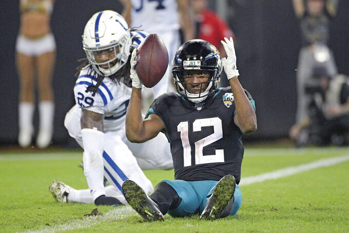 Jacksonville Jaguars wide receiver Dede Westbrook (12) signals touchdown after catching pass for a score in front of Indianapolis Colts safety Malik Hooker (29) during the second half of an NFL football game, Sunday, Dec. 29, 2019, in Jacksonville, Fla. (AP Photo/Phelan M. Ebenhack)