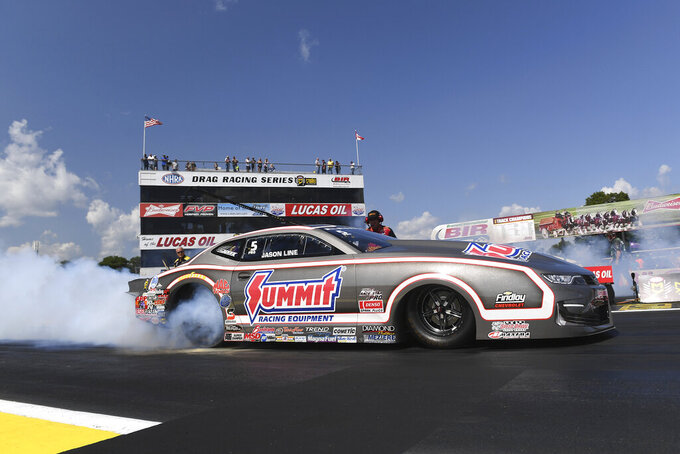 In this photo provided by the NHRA, Jason Line drives in Pro Stock qualifying Friday, Aug. 16, 2019, at the Lucas Oil NHRA Nationals drag races at Brainerd International Raceway in Brainerd, Minn. Line had a run of 6.606 seconds at 207.27 mph. (Marc Gewertz/NHRA via AP)