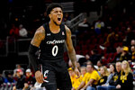 Cincinnati guard Chris McNeal (0) yells during the second half of the team's NCAA college basketball game against Iowa, Saturday, Dec. 21, 2019, in Chicago. (AP Photo/Matt Marton)