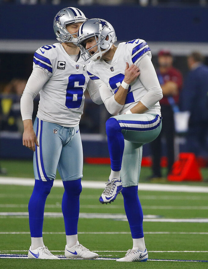 Dallas Cowboys place kicker Brett Maher (2) and Chris Jones (6) react to Maher missing on a 58-yard field goal attempt in the first half of the NFC wild-card NFL football game against the Seattle Seahawks, in Arlington, Texas, Saturday, Jan. 5, 2019. (AP Photo/Ron Jenkins)