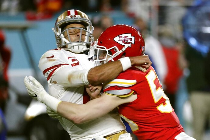 Kansas City Chiefs linebacker Ben Niemann, right, hits San Francisco 49ers quarterback Jimmy Garoppolo during the second half of the NFL Super Bowl 54 football game Sunday, Feb. 2, 2020, in Miami Gardens, Fla. (AP Photo/Matt York)