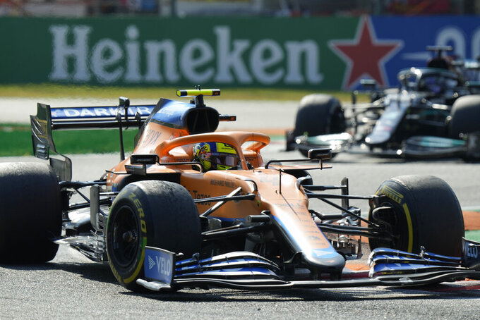 Mclaren driver Lando Norris of Britain steers his car during the Italian Formula One Grand Prix, at Monza racetrack, in Monza, Italy, Sunday, Sept.12, 2021. (AP Photo/Luca Bruno)