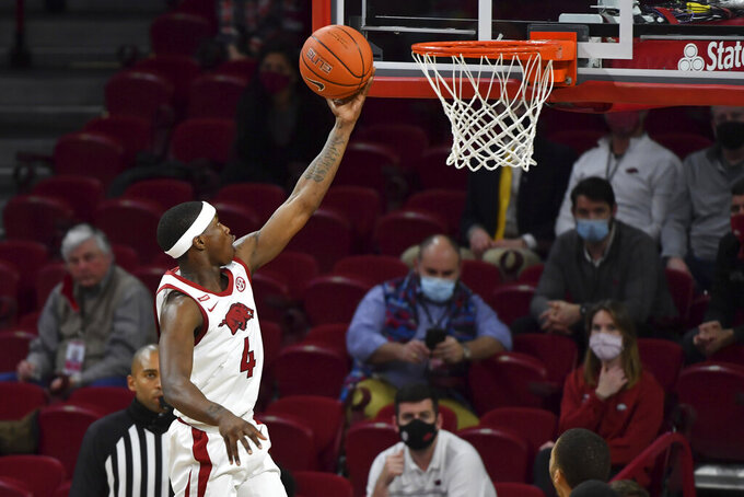 Arkansas guard Davonte Davis goes up for a lay up against Mississippi during the second half of an NCAA college basketball game Wednesday, Jan. 27, 2021, in Fayetteville, Ark. (AP Photo/Michael Woods)