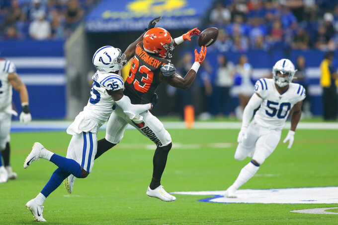 FILE - In this Aug. 17, 2019, file photo, Cleveland Browns wide receiver D.J. Montgomery (83) drops a pass as he's hit by Indianapolis Colts cornerback Pierre Desir (35) during the first half of an NFL preseason football game in Indianapolis. Recently re-signed cornerbacks Desir and Kenny Moore II and second-round draft Rock Ya-Sin, an emerging playmaker, could help the Colts become a top-10 defense. (AP Photo/AJ Mast, File)