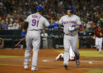 New York Mets' Wilson Ramos celebrates with Carlos Gomez (91) after hitting a solo home run against the Arizona Diamondbacks in the second inning during a baseball game, Sunday, June 2, 2019, in Phoenix. (AP Photo/Rick Scuteri)