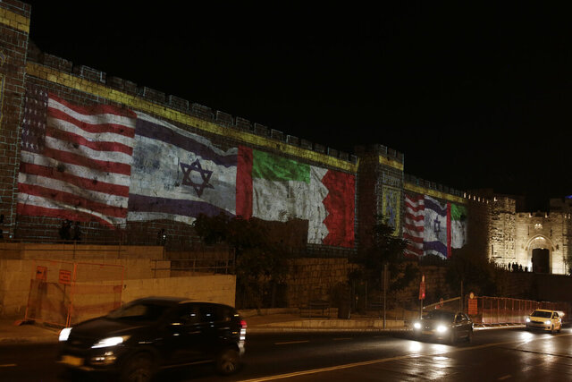Representations of the U.S., Israeli, Emirati and Bahraini flags are projected onto a wall of Jerusalem's Old City, marking the day of a signing ceremony in Washington signifying the two Gulf nations' normalization of relations with Israel, Tuesday, Sept. 15, 2020. (AP Photo/Maya Alleruzzo)