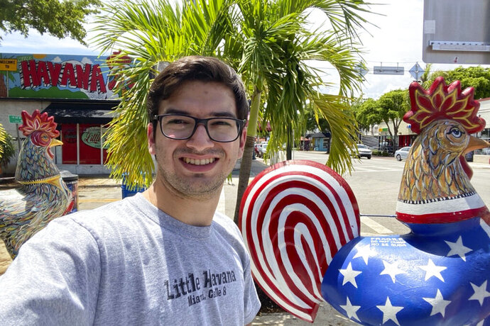 In this photo provided by Robert Lewis, Lewis takes a selfie in the Little Havana neighborhood in Miami, Wednesday, Aug. 5, 2020. Until recently, Lewis had never heard of Karen Bass, the California congresswoman in contention to be Democratic presidential candidate Joe Biden's running mate. But the recent college graduate had long heard stories from his grandfather recounting the days of oppression in Cuba under Fidel Castro. (Robert Lewis via AP)