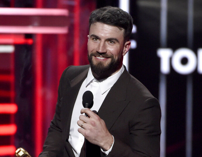 FILE - This May 20, 2018 file photo shows Sam Hunt accepting the award for top country song for