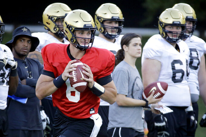 In this Aug. 5, 2019, photo, Vanderbilt quarterback Riley Neal (6) runs a drill during an NCAA college football practice in Nashville, Tenn. Vanderbilt has won at least five games each of the past three seasons and reached two bowls in that span. They've also won three straight against in-state rival Tennessee for their longest winning streak in this series since the 1920s. (AP Photo/Mark Humphrey)