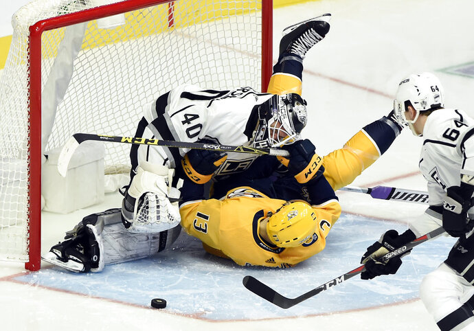 Nashville Predators center Nick Bonino (13) collides with Los Angeles Kings goaltender Calvin Petersen (40) after Bonino attempted a shot during the second period of an NHL hockey game Saturday, Nov. 17, 2018, in Nashville, Tenn. (AP Photo/Mark Zaleski)
