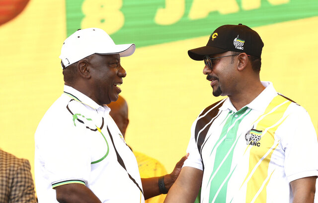 Ethiopian Prime Minister Abiy Ahmed Ali, right, talks with African National Congress (ANC) president and South African President Cyril Ramaphosa at the party's 108th birthday celebrations in Kimberley, South Africa, Saturday, Jan. 11, 2020. (AP Photo)