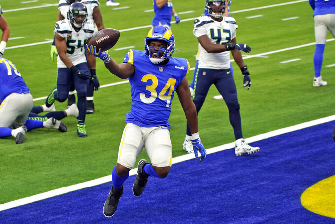 Los Angeles Rams running back Malcolm Brown (34) celebrates after scoring against the Seattle Seahawks during the first half of an NFL football game Sunday, Nov. 15, 2020, in Inglewood, Calif. (AP Photo/Ashley Landis)